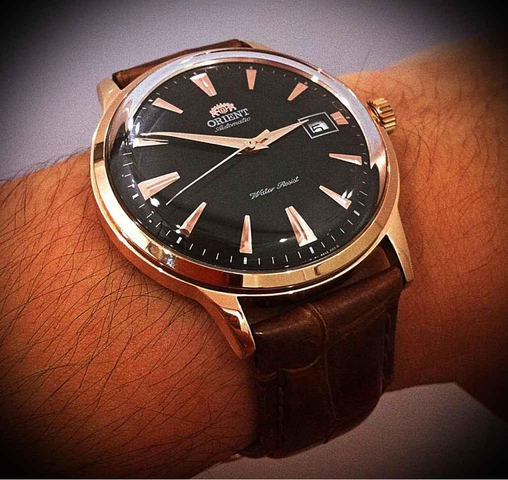 Aidez-moi pour choisir... 1064048d1367079739-affordable-dress-watch-orient-bambino-70d0596b-5b61-452b