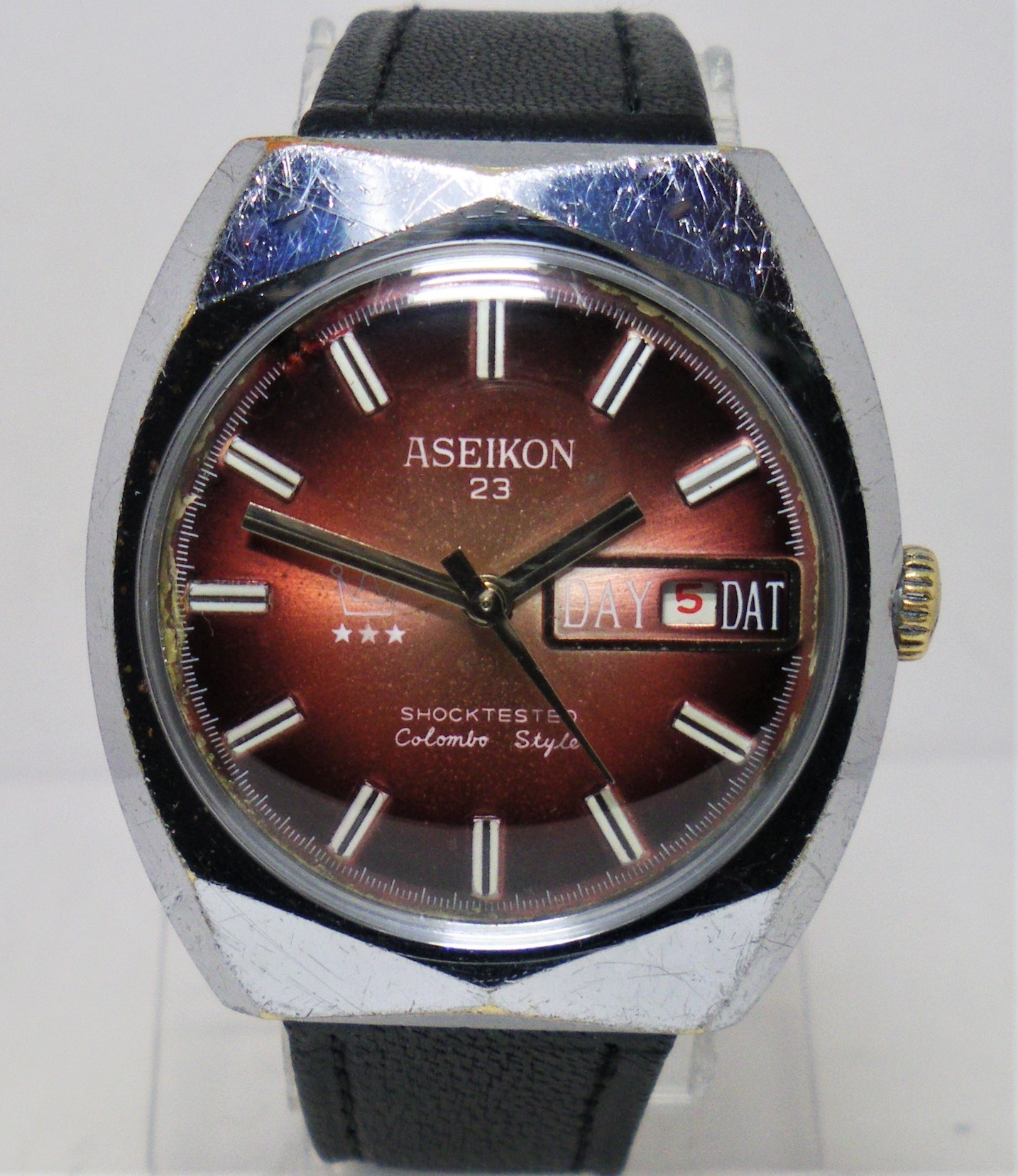 Click image for larger version.  Name:Aseikon 23 branded Ruhla 24-33 Colombo Style Red dial.JPG Views:255 Size:520.7 KB ID:13548371
