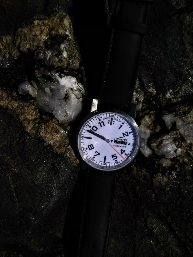 Name:  Fortis SpaceMatic white dial on ocean jetty boulder.JPG Views: 44 Size:  117.1 KB