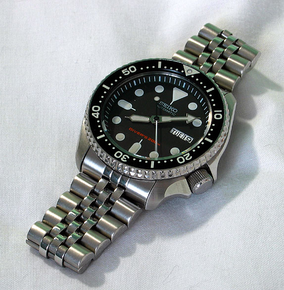 I think the SKX007 is a great choice. 41mm, classic look, and available for
