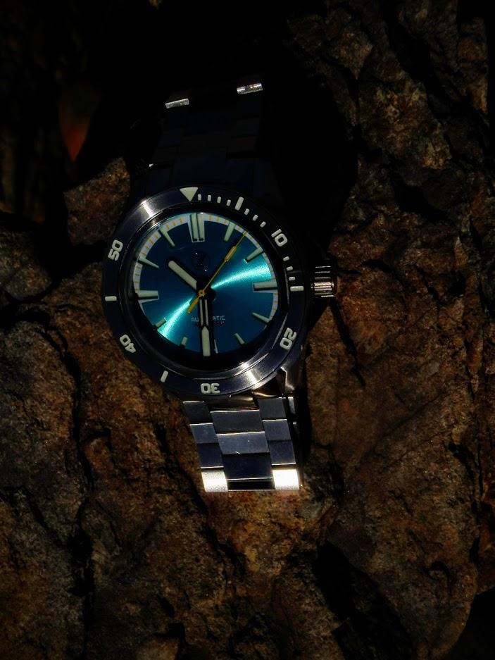 Name:  Zelos SwordFish Aqua dial on beach rock.JPG Views: 43 Size:  122.0 KB
