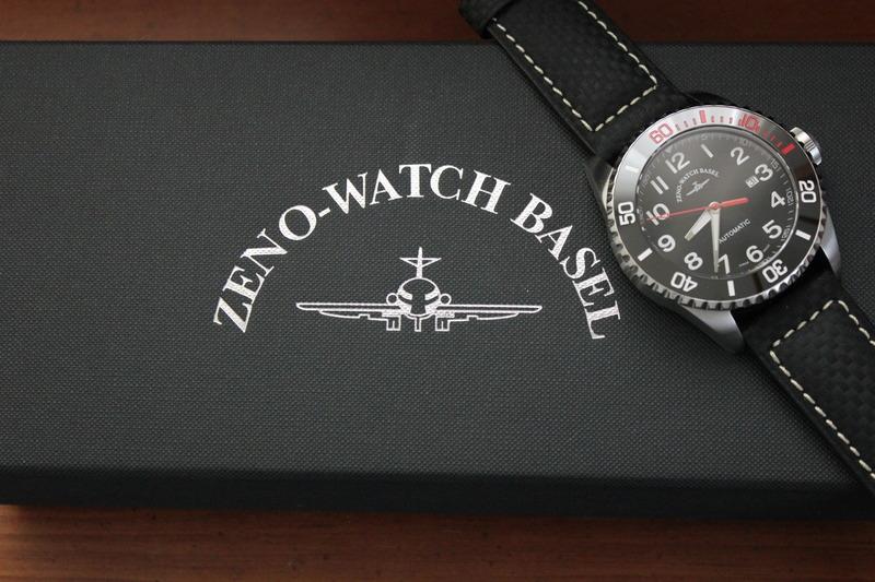 Name:  Zeno Watch Basel Ceramic Diver 6492- 2824-A1-7 on carbon fiber w:white stitching strap from Pan.jpeg Views: 35 Size:  127.8 KB