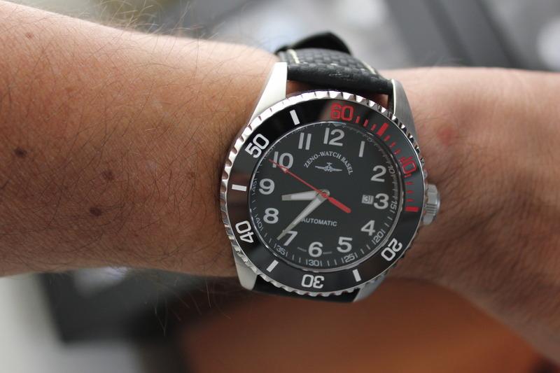 Name:  Zeno Watch Basel Ceramic Diver 6492- 2824-A1-7 on carbon fiber w:white stitching strap from Pan.jpeg Views: 37 Size:  95.9 KB