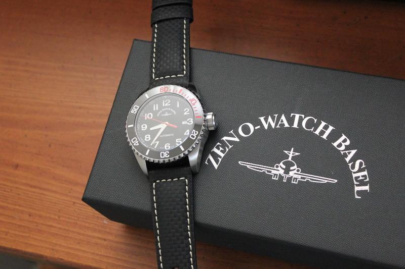 Name:  Zeno Watch Basel Ceramic Diver 6492- 2824-A1-7 on carbon fiber w:white stitching strap from Pana.jpg Views: 20 Size:  120.1 KB