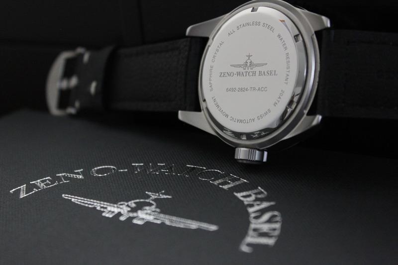 Name:  Zeno Watch Basel Ceramic Diver 6492- 2824-A1-7 on carbon fiber w:white stitching strap from Pana.jpg Views: 20 Size:  71.2 KB
