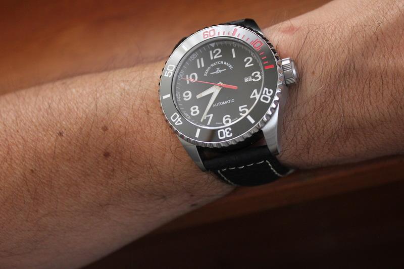 Name:  Zeno Watch Basel Ceramic Diver 6492- 2824-A1-7 on carbon fiber w:white stitching strap from Pana.jpg Views: 20 Size:  100.5 KB